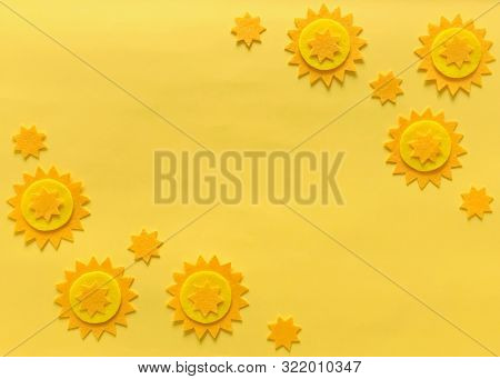Sunny yellow background with felt stars and copy space. Crafting supplies for creative arts, DIY. Background for blog titles, flyers, announcements, headers, catalogs, broshures, postcard, stationery stock photo