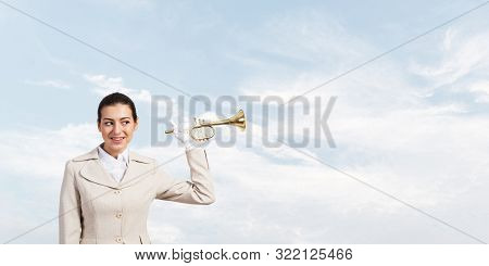 Beautiful Woman Holding Trumpet Brass Near Ear And Listening. Young Businesslady In White Business S