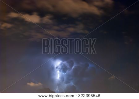 Powerful Lightning bolts strike in the stormy weather sky. stock photo