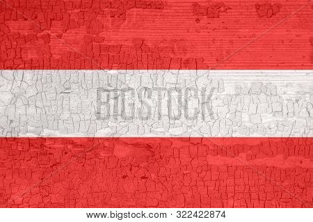 Austria flag on an old painted tattered wooden surface. Textured background for design. stock photo