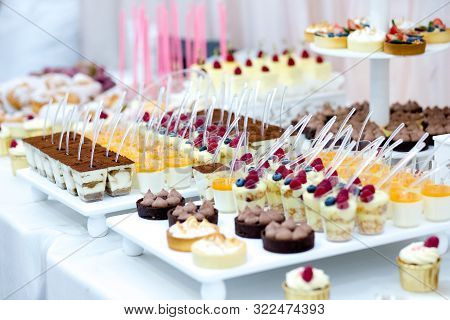 Sweet dessert table or candy bar. Wedding party. Candy bar with macarons, cakes, cake pops, close up. stock photo