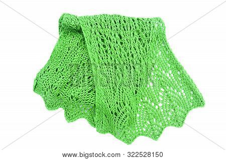 Knitted green scarf on an isolated white background.  Handmade crafted fiber art fashion accessory in a bright kelly green color in a lace pattern. stock photo