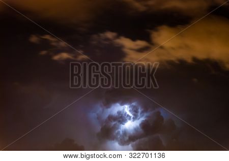 A Lightning at cloudy dark Night scene. Selective focus. stock photo