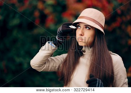 Allergic Woman Using Eye Drops in Autumn Season stock photo