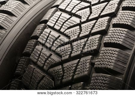 winter tires Velcro without spikes friction, used, close-up on a black background. slats and grooves. safe riding in winter, Chinese production stock photo