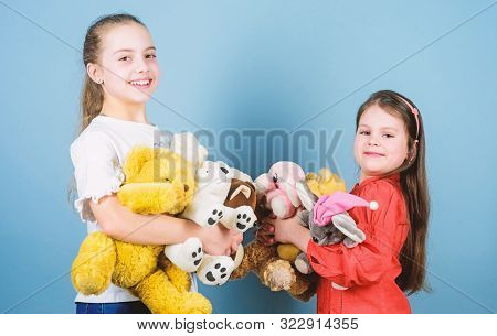 Child care. Sisters best friends play. Sweet childhood. Childhood concept. Softness and tenderness. Charity sale. Love and friendship. Kids adorable cute girls play soft toys. Happy childhood stock photo