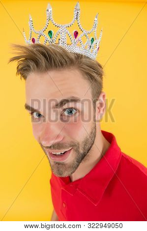 Funky prince. Glory seeking man. Man representing power and triumph. Business king. Cheerful guy wear crown. King of style. Achieving victory and success. Narcissistic prince. Prince golden crown. stock photo