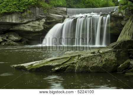 East Falls in Elyria Ohio. This large waterfall is found in the middle of an urban area near Cleveland Ohio. stock photo