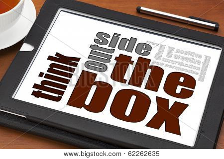 think outside the box concept on a digital tablet with cup of tea