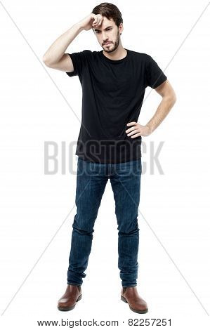 Young man worried about his mistake hand on forehead. stock photo