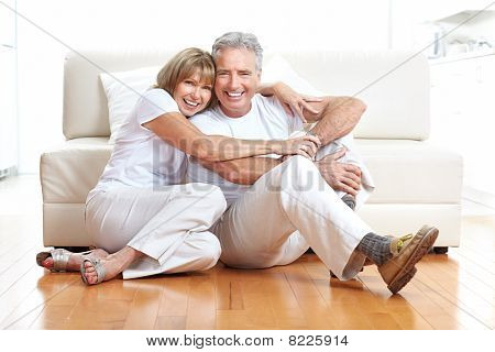 Senior couple at home smiling and happy stock photo