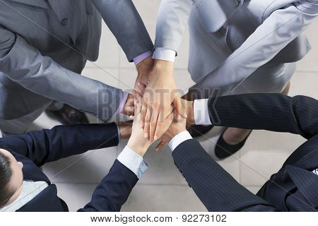 Close up of business peoples hands on top of each other stock photo