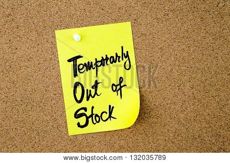 Business Acronym TOS Temporarly Out Of Stock written on yellow paper note pinned on cork board with white thumbtack copy space available stock photo