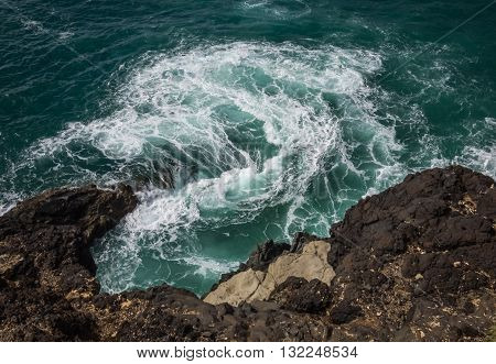 Sea water whirpool on the rocky coast in Ajuy, Parque Rural de Betancuria in Fuerteventura, Canary Island, Spain stock photo