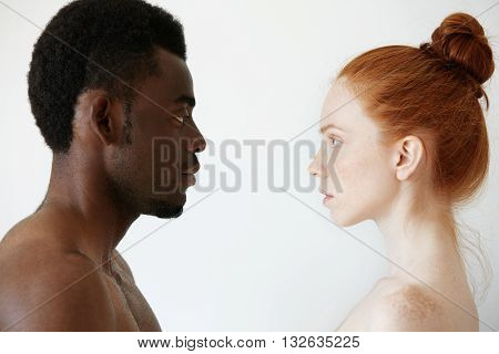 Deep connection between two young people of different races looking at each other with pure unconditional love and affection loving supporting and caring for each other. Interracial relationships stock photo