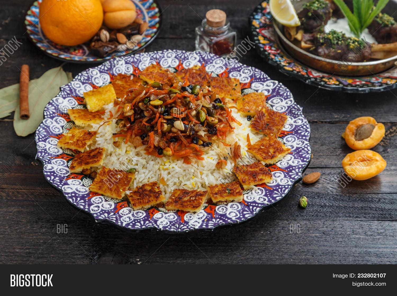 appetizer,apricot,braised,chicken,closeup,colorful,cuisine,curry,dark,dinner,dish,dried,food,fresh,garnish,glazed,gourmet,healthy,homemade,honey,ingredient,jeweled,jeweledrice,jewish,kitchen,lunch,meal,mediterranean,mixed,nobody,pepper,persian,pilaf,pommegranate,prepared,prunes,pumpkin,rice,rustic,sauce,seed,snack,tasteful,tasty,traditional,turmeric,vegan,vegetable,vegetarian,wooden