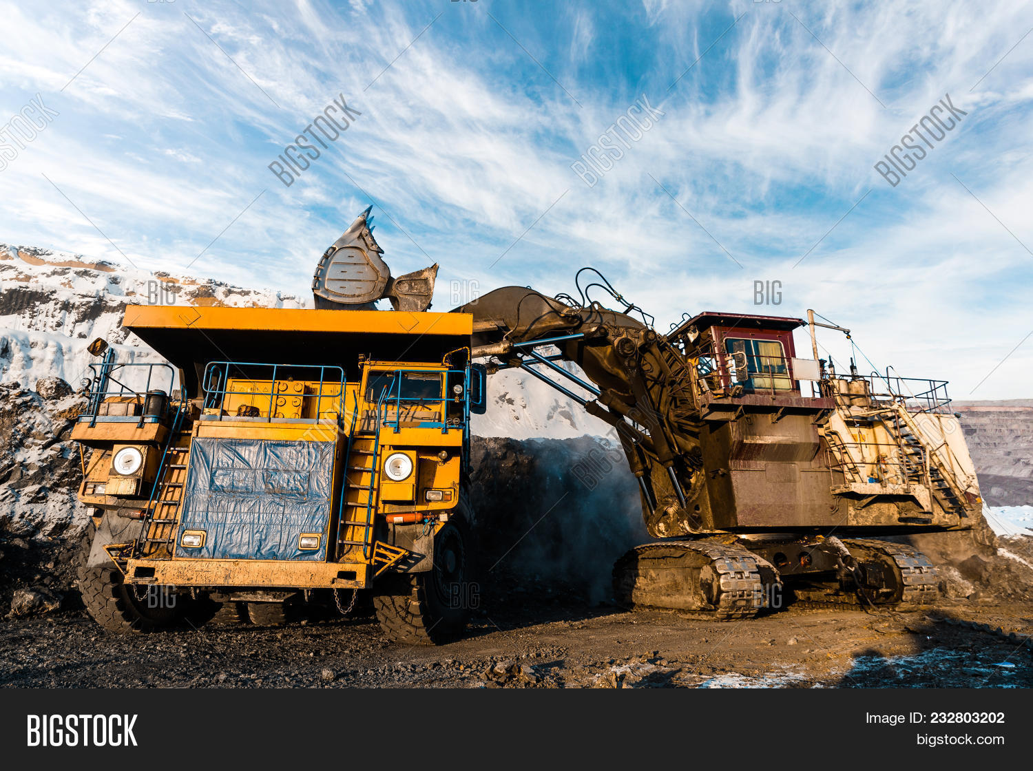 Large Quarry Dump Truck. Loading The Rock In The Dumper. Loading Coal Into Body Work Truck. Mining T