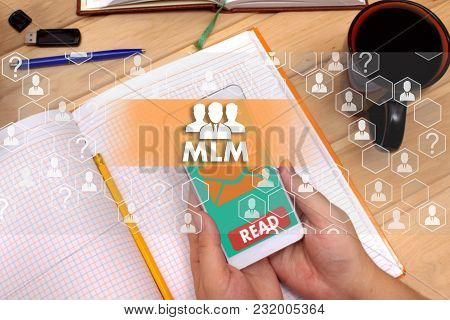 Multi-level marketing. MLM on the touch screen to the network, on office blur background.Concept of Multi-level marketing, MLM stock photo