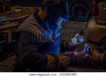 Welder at orbital welding machine closer look stock photo