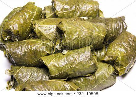 Grape leaves rolls. Sarmale, dolma, sarma, dolmades, golubtsy or golabki. East European and Asian traditional cuisine. stock photo