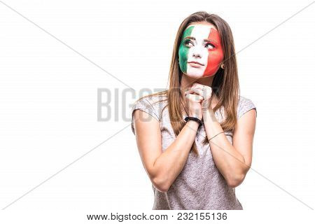 woman supporter fan of Mexico national team painted flag face get unhappy sad frustrated emoitions into a camera. stock photo