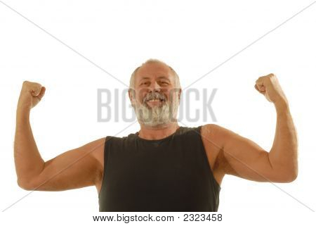 Happy older man flexing during his fitness routine; isolated on white stock photo