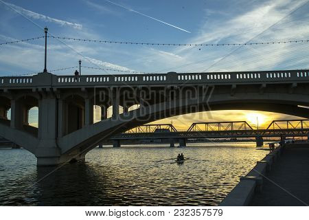 Light rail and Mill Street bridges over Tempe Town Lake near Phoenix, Arizona stock photo
