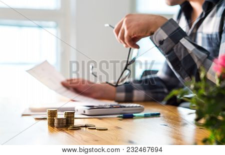 Financial Problems, Recession, Bankruptcy Or Foreclosure Concept. Unhappy Sad Man Reading Letter, Bi