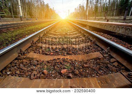 railroad tracks receding to the horizon line stock photo