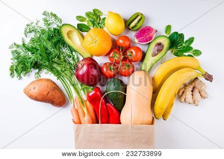 Healthy Food Background. Healthy Food In Paper Bag Fruits And Vegetables On White. Vegetarian Food.
