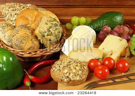 Food assortment in basket and on the table. stock photo
