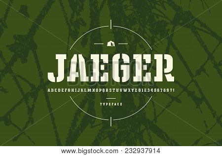 Original stencil-plate slab serif font. Bold face. Letters and numbers for logo and emblem design. White print on green texture background stock photo