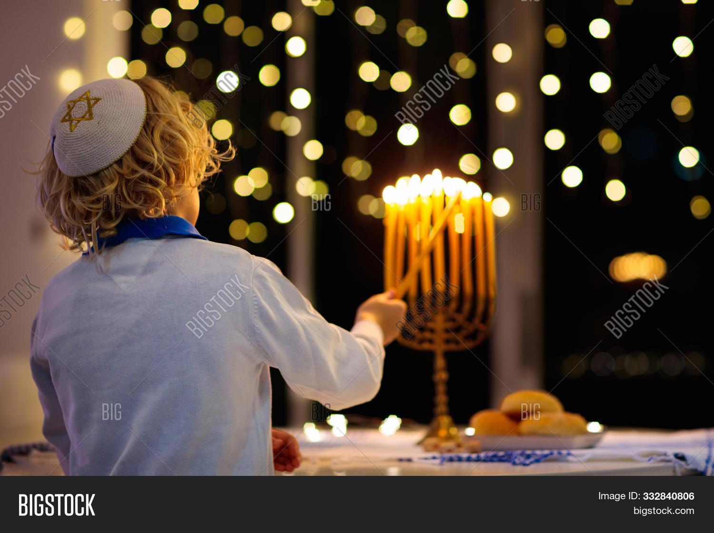 baby,boy,bright,burning,candle,celebrate,celebration,chanukah,child,culture,curly,david,december,dreidel,faith,family,festival,festive,flame,food,girl,hanuka,hanukkah,happy,hat,hebrew,holiday,home,israel,israeli,jew,jewish,judaic,judaism,kid,kippah,light,little,menorah,person,religion,religious,star,symbol,together,tradition,traditional,young