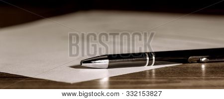 Banner, pen and paper on wooden table, concept contract, submission or last will, copyspace stock photo