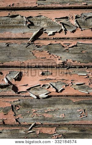Peeling brown paint on weathered wood texture. Abstract architecture background stock photo