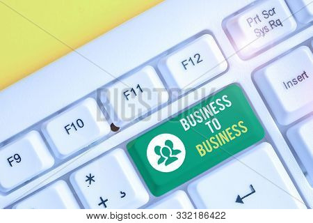 Word writing text Business To Business. Business concept for Commercial Transaction between two Businesses White pc keyboard with empty note paper above white background key copy space. stock photo