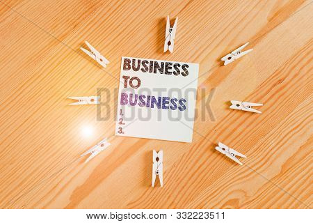 Word writing text Business To Business. Business concept for Commercial Transaction between two Businesses Colored clothespin papers empty reminder wooden floor background office. stock photo