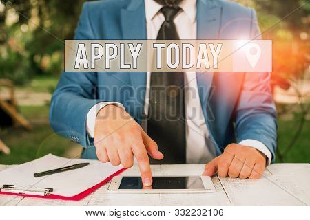 Writing note showing Apply Today. Business photo showcasing to request something mainly in writing or by sending in a form Businessman with pointing finger in front of him. stock photo