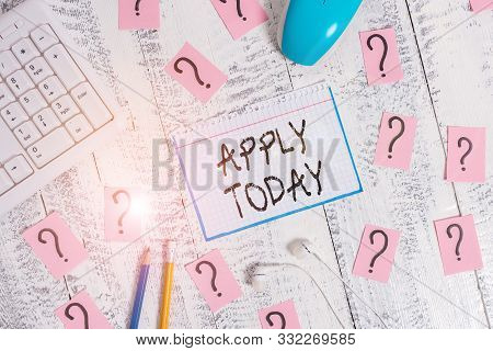 Conceptual hand writing showing Apply Today. Business photo text to request something mainly in writing or by sending in a form Writing tools and scribbled paper on top of the wooden table. stock photo