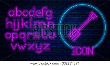 Glowing neon Garden pitchfork icon isolated on brick wall background. Garden fork sign. Tool for horticulture, agriculture, farming. Neon light alphabet. Vector Illustration stock photo