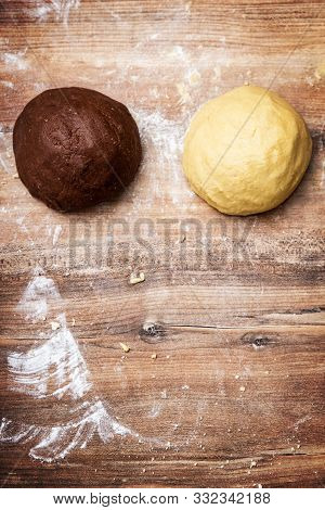 Two raw dough balls for cookies or shortcrust pastry, chocolate and vanilla flavoured, copyspace stock photo