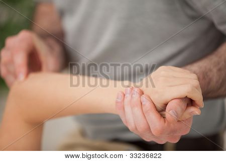 Arm of a woman being manipulated in a room stock photo