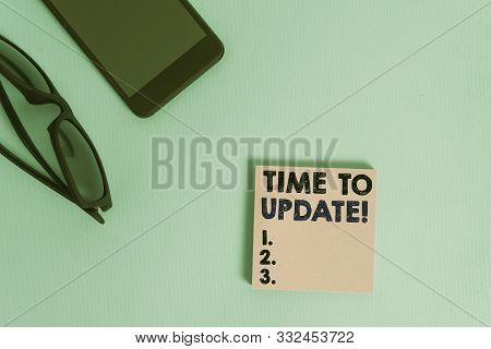 Text sign showing Time To Update. Conceptual photo act updating something someone or updated version program Dark eyeglasses colored sticky note smartphone fashion pastel background. stock photo