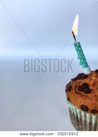Happy birthday background - birthday cupcake with burning candle. Holidays greeting card stock photo
