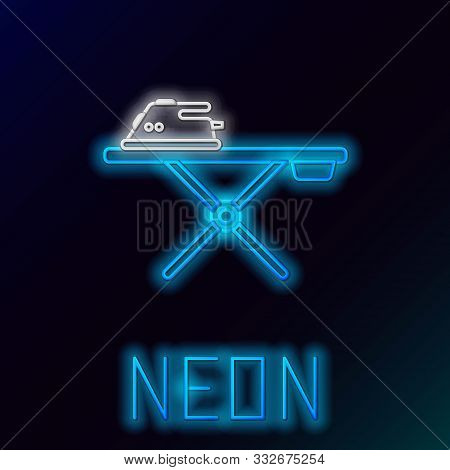 Blue glowing neon line Electric iron and ironing board icon isolated on black background. Steam iron. Colorful outline concept. Vector Illustration stock photo