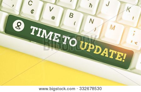 Writing note showing Time To Update. Business photo showcasing act updating something someone or updated version program White pc keyboard with note paper above the white background. stock photo