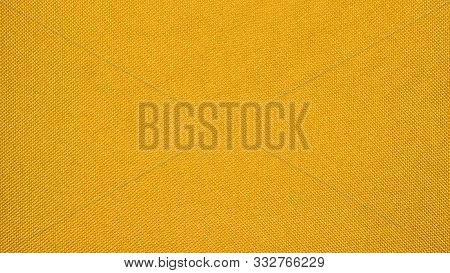 Yellow texture of binding fabric.Yellow fabric background.Yellow fabric. Background with a textured surface. stock photo