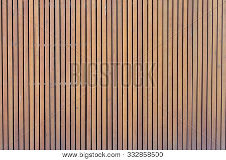 pattern of modern wall with vertical wooden panel, slats. background of wooden boards. wooden fence texture. wood plank with pattern for design and architecture stock photo