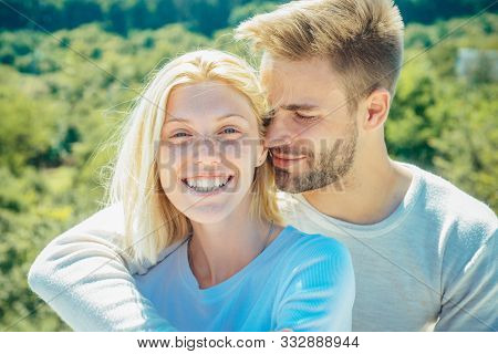 Romantic portrait of a sensual couple in love. Enjoying tender warm pleasant moment of love. Romantic couple caressing in bed stock photo