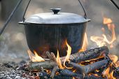 Cooking on pit fire.